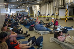 Evacuated tourists aboard the HMNZS Canterbury wait to be transported to Christchurch.