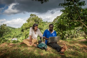 In the village of Kaliti, about 20 miles from Kampala, Hofmanis and Nabwana watch video rushes while waiting to shoot night scenes