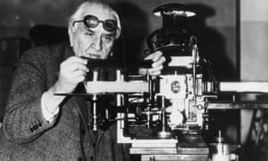 French pioneer filmmaker Louis Lumière with projecting apparatus for his new anaglyph stereoscopic film system, 1935. He is wearing the coloured glasses needed to view the film in 3D.
