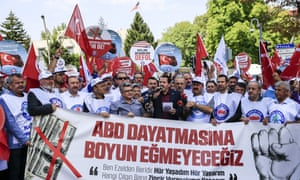 Members of trade unions protest against US sanctions against two Turkish ministers, outside the US Embassy in Ankara, Turkey.