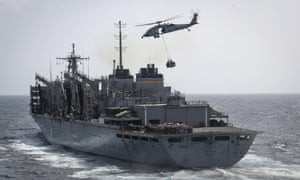 Sea Hawk helicopters transport supplies to the USS Abraham Lincoln in the Arabian Sea.