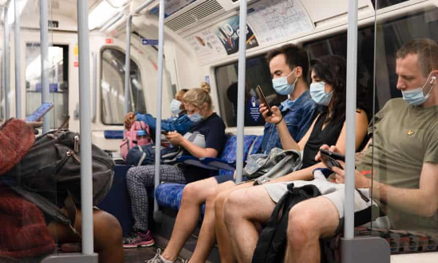 People wearing face masks on public transport in London.