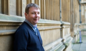 Danny Dorling leaning against a wall in Oxford.