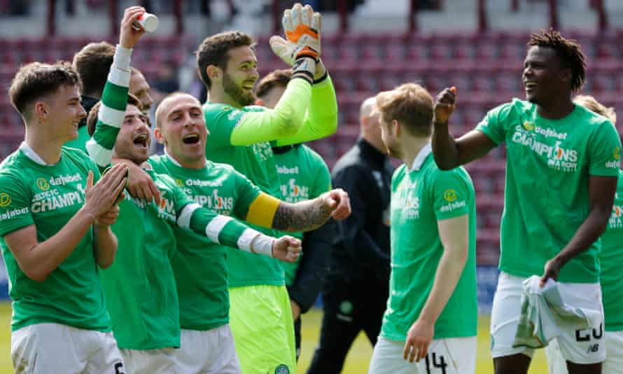 Celtic's players celebrate clinching the title after the victory over Hearts.