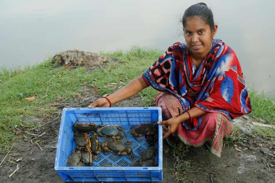 Sathi Das shows crabs from her afternoon catch.