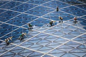 """Abu Dhabi, United Arab Emirates, by Volker Sander: """"The photo is an example of needful interaction between humans and buildings. Without the busy people cleaning the giant glass frames of the tower, the building would look quite ugly."""""""