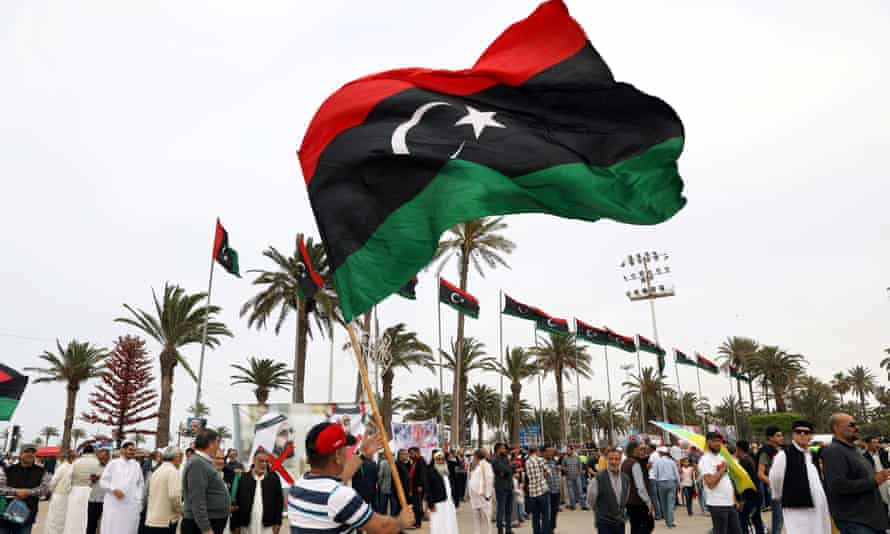 A man waves a Libyan flag during a demonstration in April to demand an end to Khalifa Haftar's offensive against Tripoli