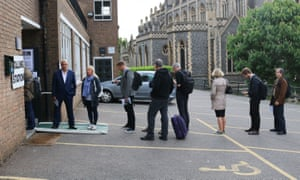 The first voters queue at the polling station in Sacred Heart church in Wimbledon