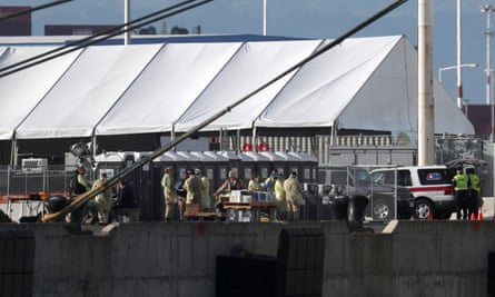 Medical personnel prepare to screen passengers as they disembark from the Grand Princess cruise ship on 10 March 2020 in Oakland, California.