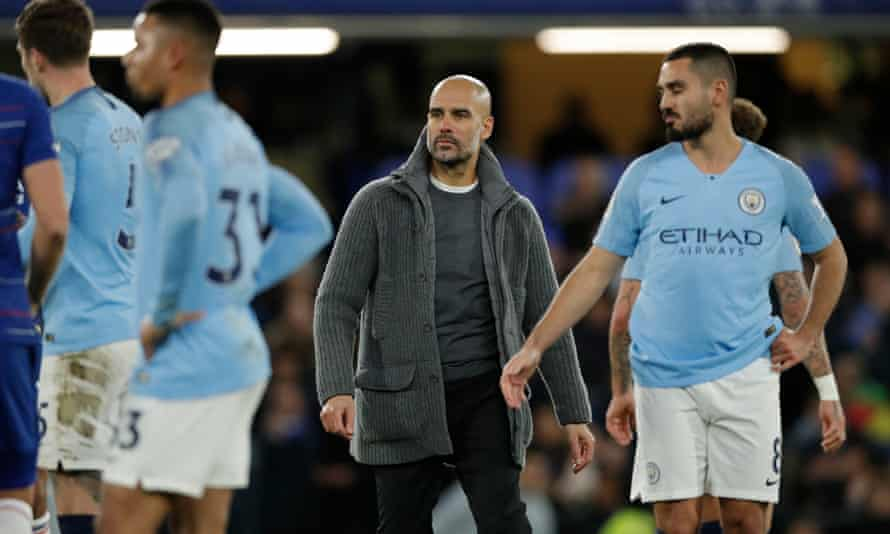 Guardiola and his players after their defeat at Chelsea, who exploited the space behind the City full-backs