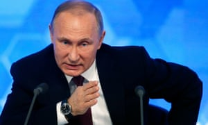 Vladimir Putin answers a question during his annual press conference in Moscow.