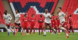 Arsenal players react as Pierre-Emerick Aubameyang scores the winning penalty,