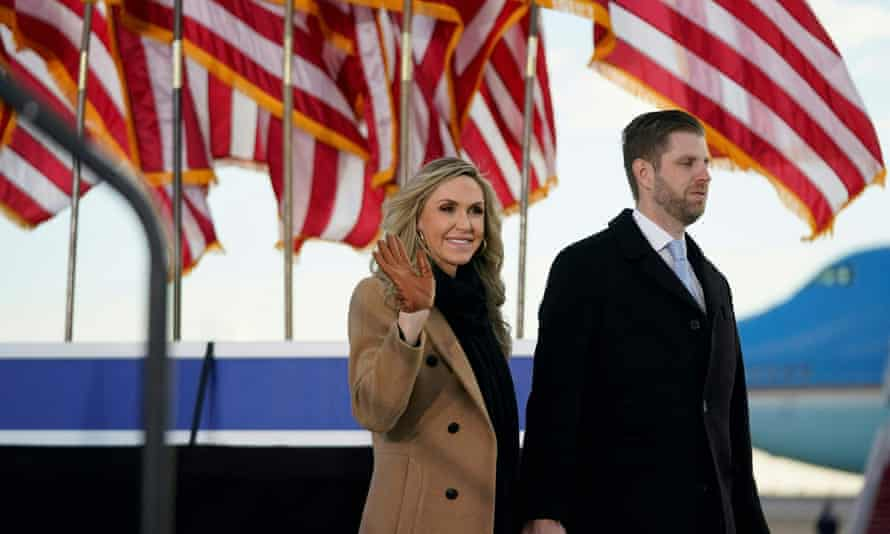 Lara and Eric Trump arrive for Donald Trump and Melania Trump's farewell at Joint Base Andrews in Maryland.