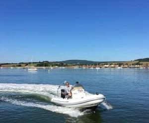James Edge on a speedboat