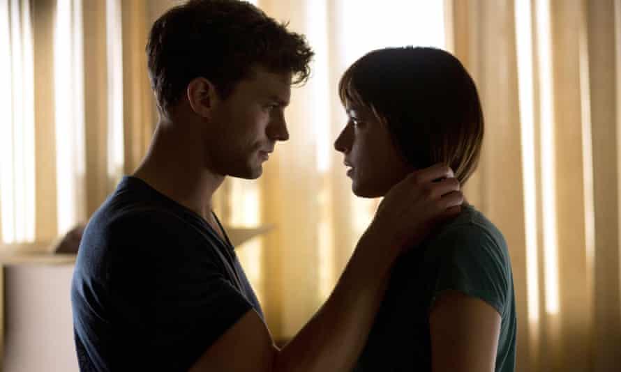 Jamie Dornan and Dakota Johnson in the film of Fifty Shades Of Grey
