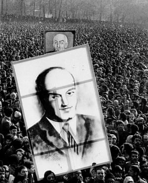 Revolutionaries hold up large pictures of Ali Shariati (front) and Prime Minister Mohammad Mossadegh (back).