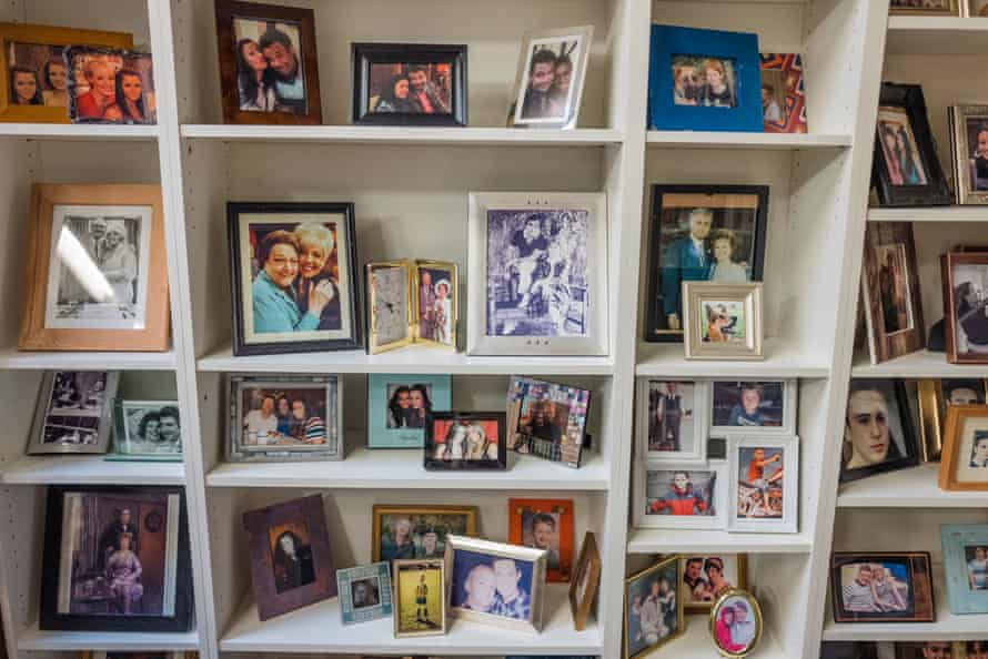 A shelf of photos from former characters' homes in the props department.