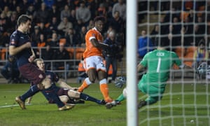 Blackpool's Armand Gnanduillet is denied by Arsenal's keeper Petr Cech.
