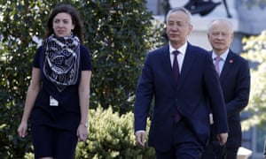 China's Vice-Premier Liu He, second from right, arrives at the West Wing of the White House in Washington for a meeting with Donald Trump, on Friday.