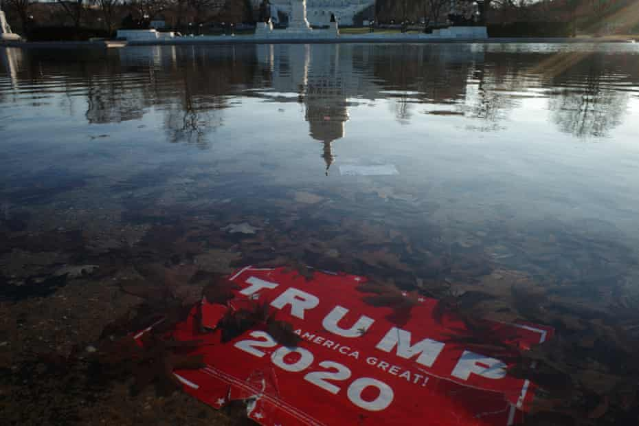 trump sign under water in capitol reflecting pool