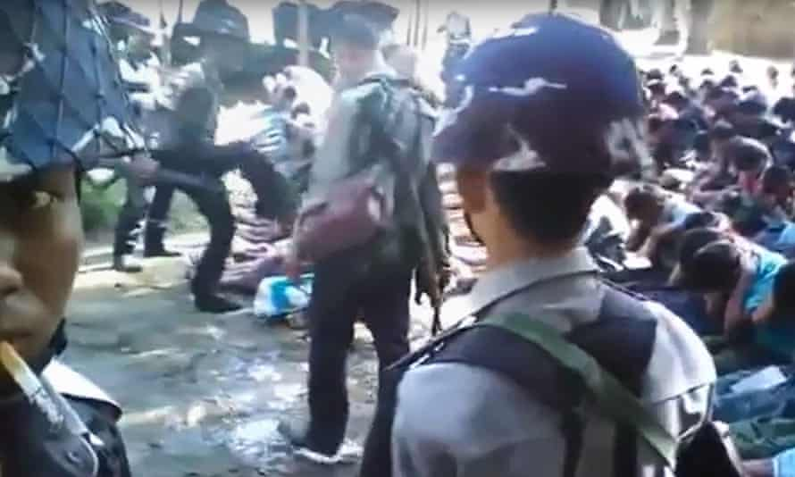 A still from a video shot by Constable Zaw Myo Htike shows a policeman kicking a Rohingya man