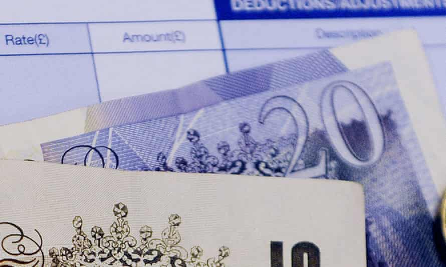 UK payslip and £20 notes