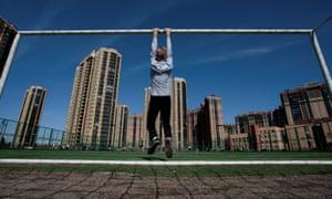 A boy hangs from a goalpost in St. Petersburg
