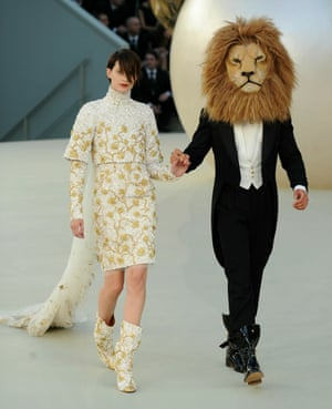 Animal magic: models walk the runway – one wearing a lion's head costume – for Chanel's Haute Couture Autumn/Winter 10/11 show