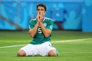 Mats Hummels on his knees after Germany loose 2-0 to South Korea and are out of the World Cup.
