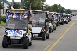 A parade of more than 300 golf carts supporting Je Biden caravan to the Sumter county elections office in Florida to cast their ballots on 7 October.