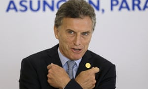 Argentina's President Mauricio Macri gestures before the official photo at the Mercosur summit in Paraguay on Monday.
