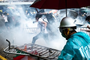 Protesters run after police fire teargas at them