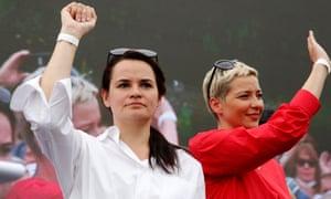 Svetlana Tikhanovskaya, left, with Maria Kolesnikova, a representative of an unofficial candidate Victor Babariko in Minsk on 19 July.