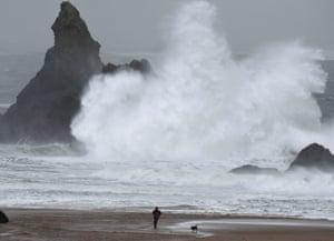 Waves crash over Church Rock at Broad Haven, Pembrokeshire, Wales