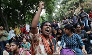 A student shouts slogans during a protest against the scrapping of the special constitutional status for Kashmir by the government in New Delhi, India
