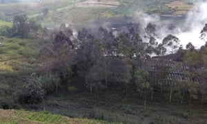 Smoke billows from Sileri Crater after it erupted in Dieng, Indonesia. A helicopter carrying eight people crashed while on the way to help with evacuations.