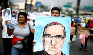 People carry a portrait of the Óscar Romero during a demonstration to ask to reopen the case of his murder. Romero will be declared saint by the Catholic church on 14 October.