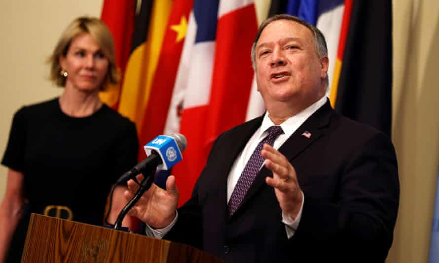 Mike Pompeo speaks as Kelly Craft listens at UN headquarters in New York on 20 August.