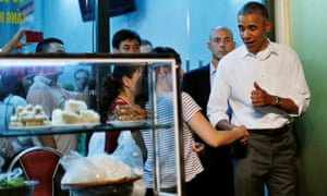 Barack Obama shakes hands with a local resident as he leaves after having a dinner with Anthony Bourdain at the Bun Cha Huong Lien restaurant in Hanoi in 2016