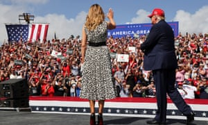 Melania Trump joins her husband Donald at his campaign rally outside Raymond James Stadium, in Tampa, Florida, on Thursday.