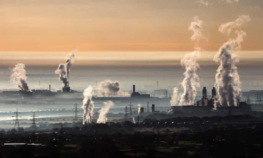 The industrial landscape across the Dee estuary at sunrise as steam rises from Deeside power station, Shotton Steelworks and other heavy industrial plants on 13 April, 2016 in Flintshire, Wales.