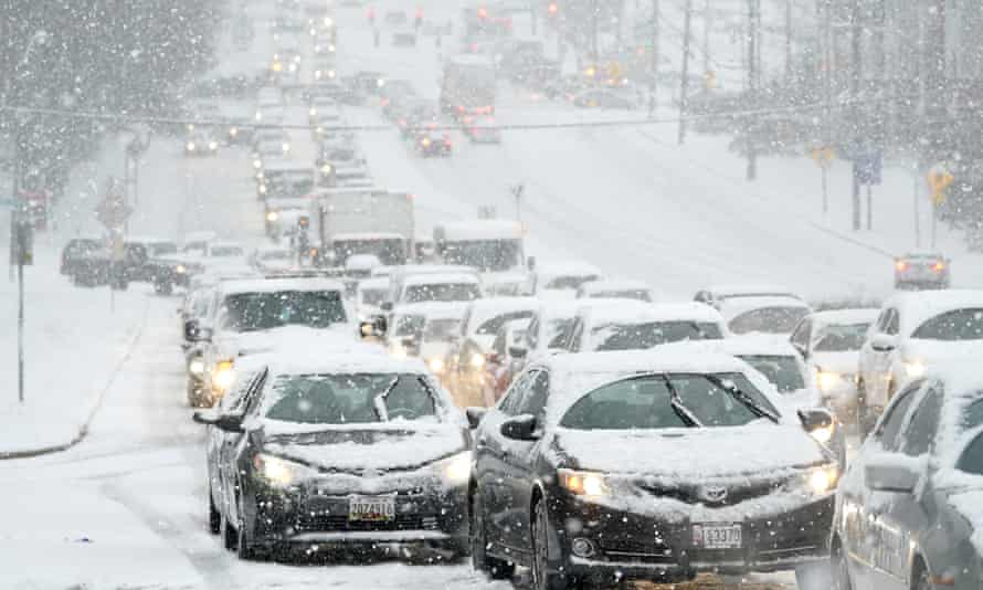 A traffic jam during a snowstorm in Towson, Maryland, 16 December. Treacherous weather could bury parts of the eastern US in snow, threatening transportation used by the vaccine manufacturing facilities.