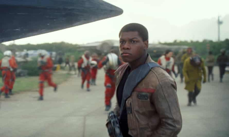 "Star Wars: The Force AwakensThis photo provided by Disney shows John Boyega as Finn, in a scene from the new film, ""Star Wars: The Force Awakens,"" directed by J.J. Abrams. The movie releases in the U.S. on Friday, Dec. 18, 2015. (Film Frame/Disney/Lucasfilm via AP)"