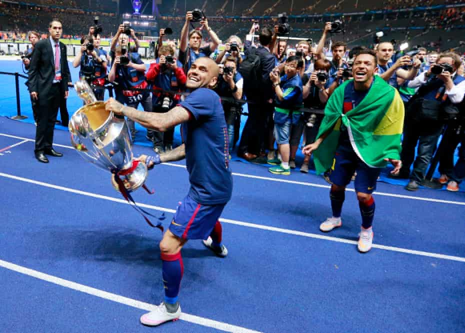 Dani Alves celebrates with the trophy after winning the Champions League with Barcelona in 2015