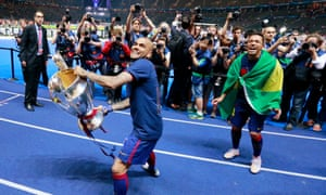 Dani Alves celebrates with the trophy after winning the Champions League in 2015, his third European Cup. 'Maybe it's easy to win a title at Barcelona, but [it's not so easy] to have a long history here.'