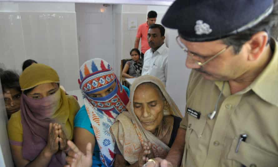 Relatives of the alleged victim remonstrate with officials in Lucknow on Tuesday.