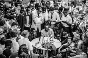 Comedian and activist Dick Gregory talks to members of the press in Birmingham on 9 May 1963