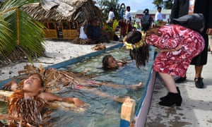 Children symbolically representing climate change greet New Zealand prime minister Jacinda Ardern as she arrives for the Pacific Islands Forum in Tuvalu, Wednesday, August 14, 2019