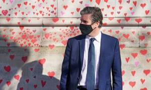 Keir Starmer visits the Covid memorial wall in central London