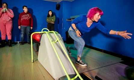 Cultural Squatters cafe manager Narina Stead and her volunteers on a trip to the local Limelight Lanes bowling alley where they paid using CounterCoin